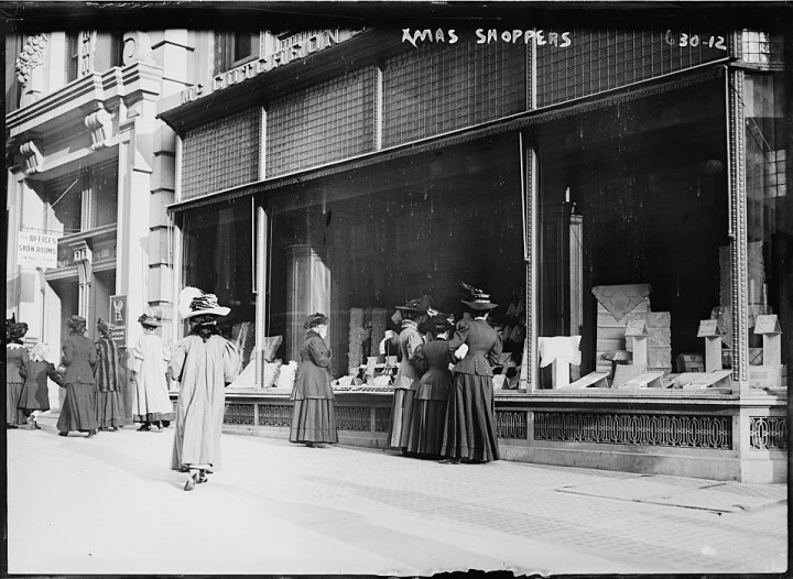 1900 circa women Christmas shopping window